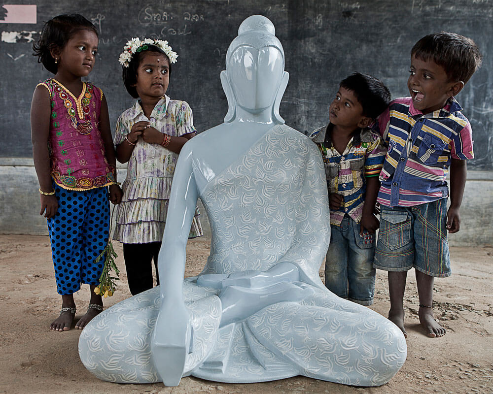 Childrens feeling entusiastic after seeing buddha peace messenger sculpture, sculpted by Sangeeta Abhay